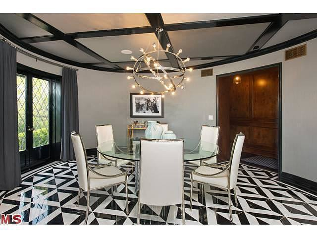 In the dining room, bold diamond-shaped tiles pop in contrasting black and white.