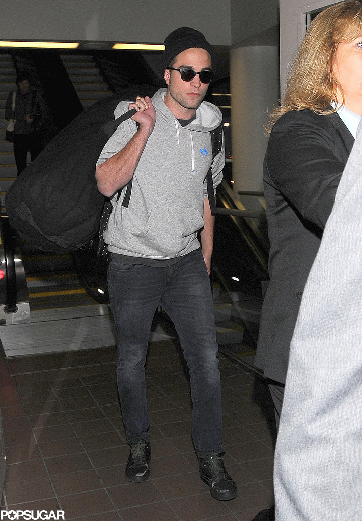 Robert Pattinson wore a beanie and sunglasses.