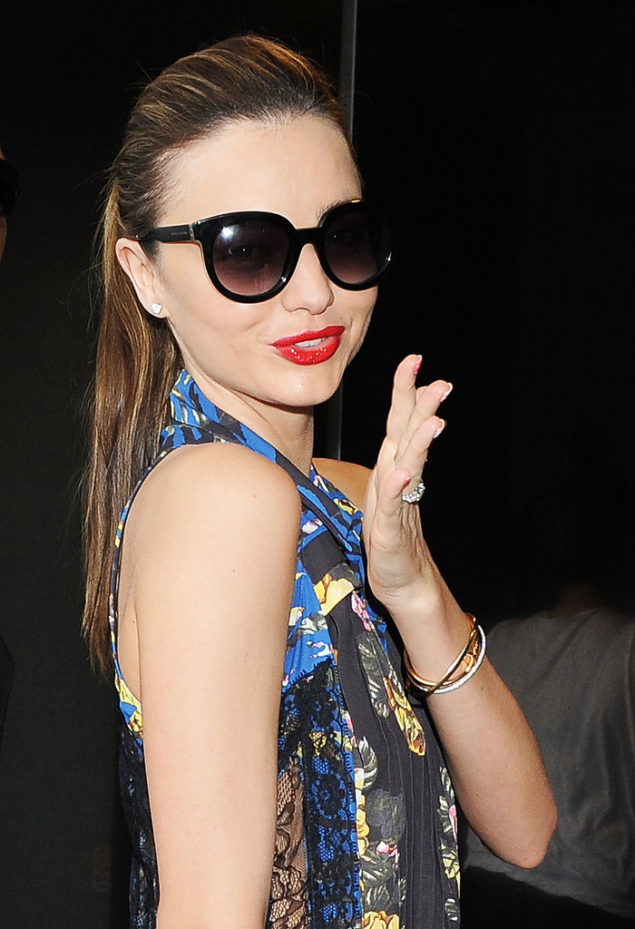 Miranda Kerr blew air-kisses while leaving Tokyo.