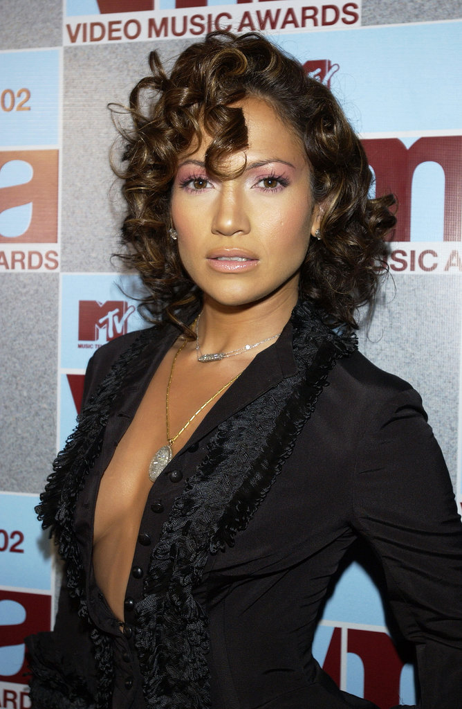 Jennifer showed off a much shorter, much curlier hairstyle at the 2002 MTV Video Music Awards. But she also proved that pink eye shadow, when applied from lash lines to eyebrows, actually can work. (Maybe just on her, though.)