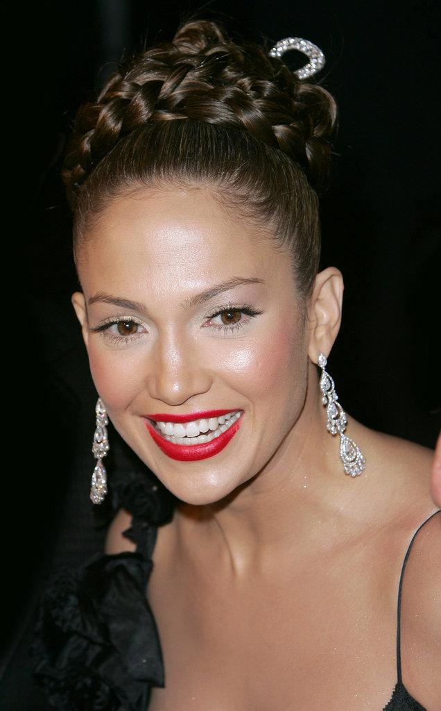 At the 2004 Met Gala, Jennifer glammed up her look with a braided updo, bold red lips, and a well-highlighted complexion.