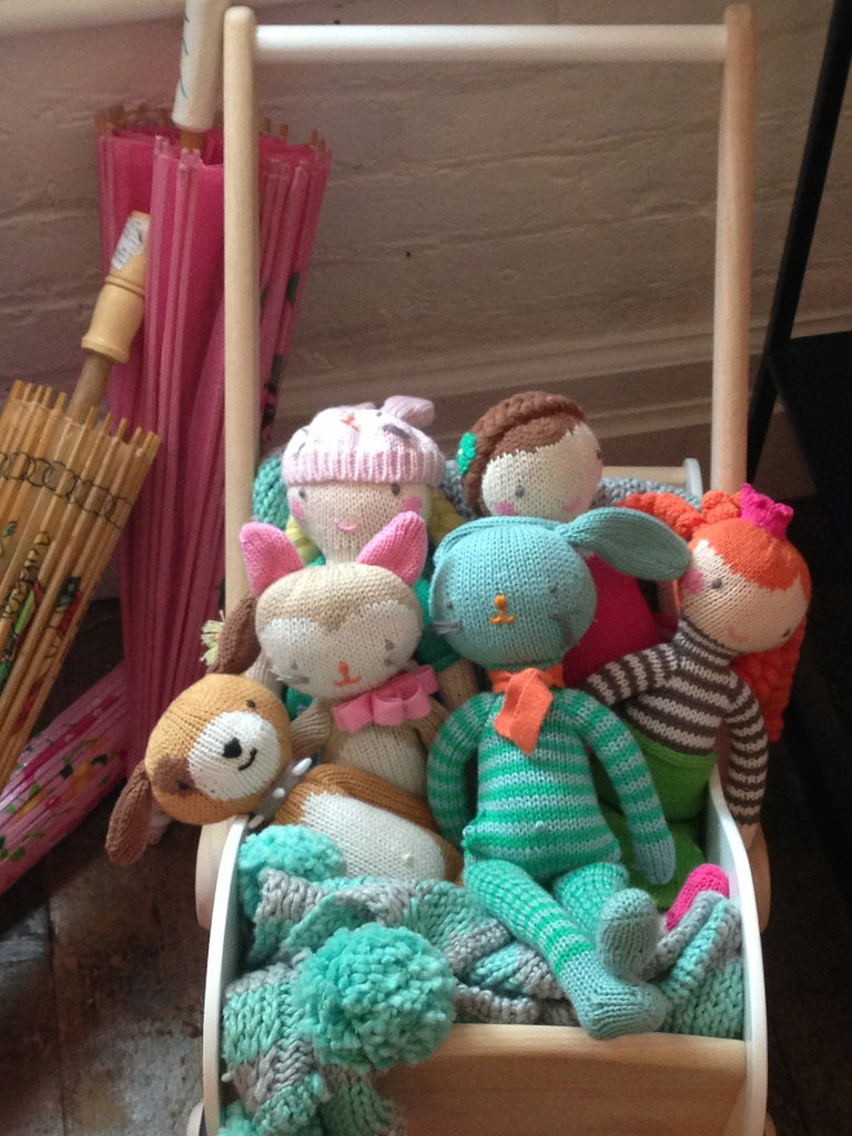 A pretty, minimalist stroller full of knit friends.