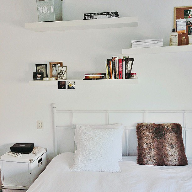 White shelving practically disappears against matching white walls, leaving the illusion of floating books and art. Source: Instagram user tesswien