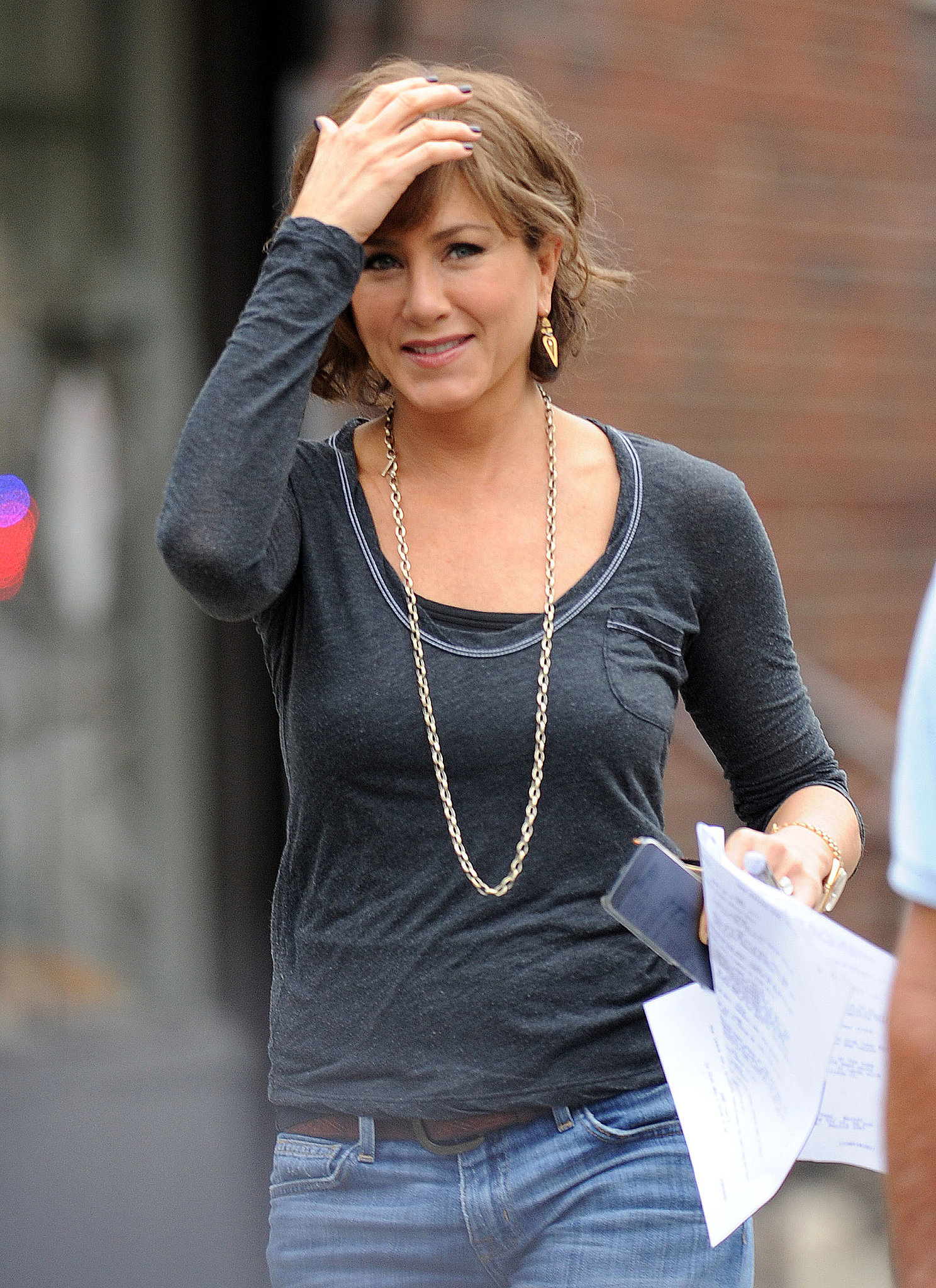 Jennifer Aniston wore a short brown wig on set on July 25.