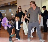 Angelina Jolie and Brad Pitt walked through the Tokyo airport with Pax, Vivienne, and Knox.