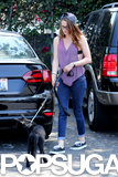 Kristen Stewart held onto her dog on a leash.