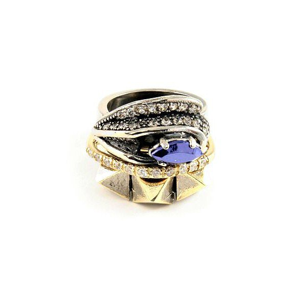 I love the look of stacked rings, and Iosselliani makes it easy by doing the actual work for you. It's been masterful at it for awhile now, and for Fall, it's doing this stack ($325) with a pretty blue stone to focus in on. — Leah Melby, associate editor