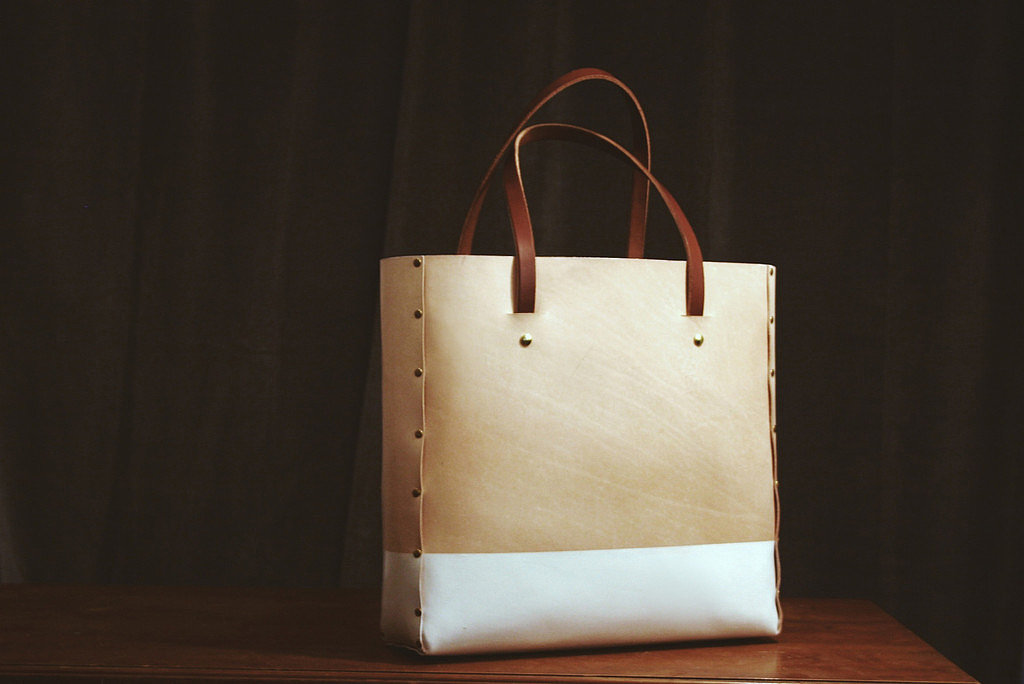 Summer gives me an urge to simplify, including paring down to a sleeker bag. Without all the heavy hardware that can weigh down a statement bag, this Dillon Des Prés Co. tote ($375) is good for lugging a laptop, magazines, and books, making it a superb carry-on for end-of-Summer trips. — LM