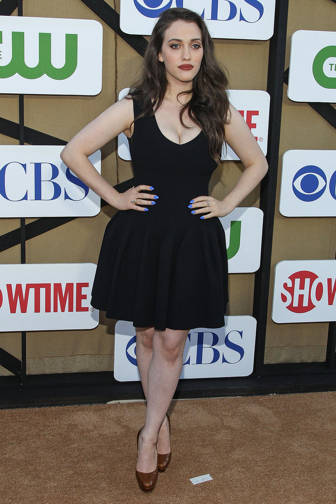 Kat Dennings kept it simple in a fit-and-flare LBD and neutral pumps — but added flair with blue nail polish.