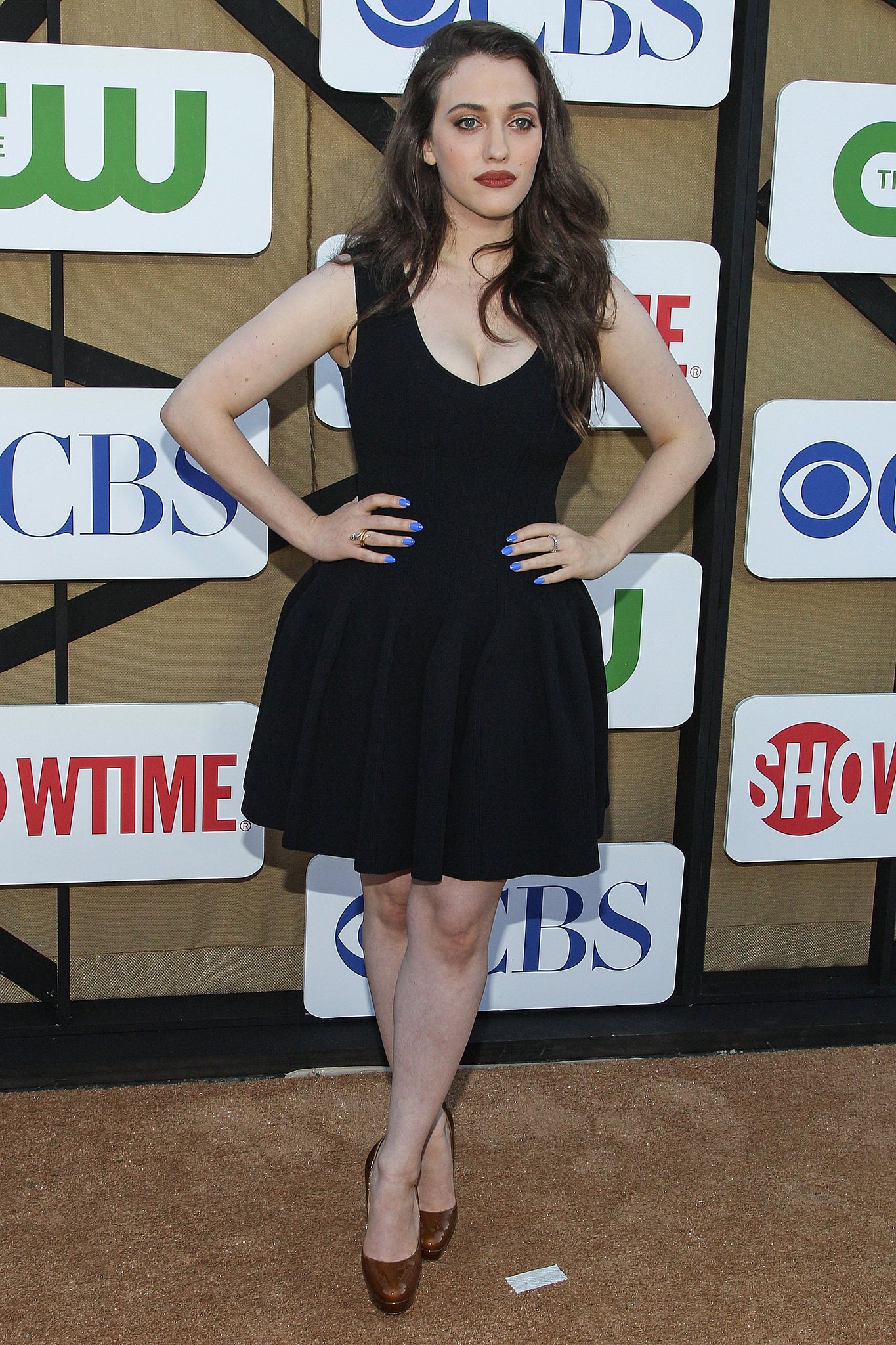 Kat Dennings posed for photos at the CW, CBS, and Showtime party.