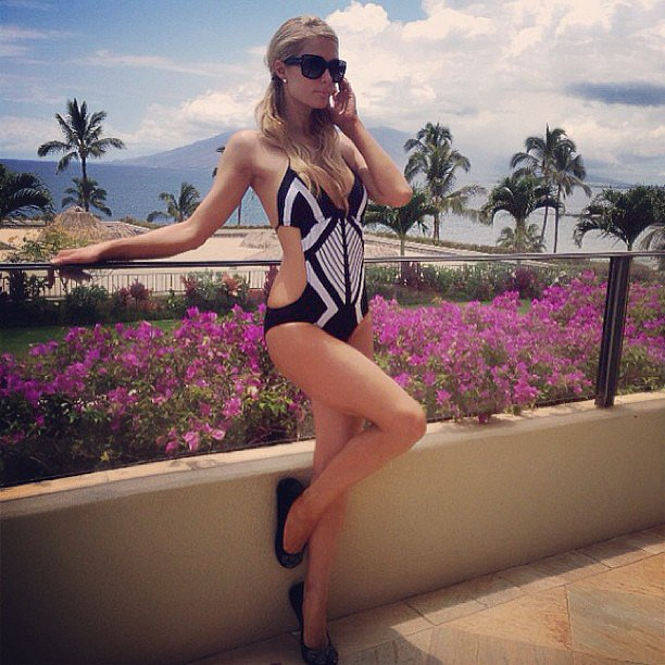 Paris Hilton sported a half-up hairstyle for her impromptu poolside photoshoot.  Source: Instagram user parishilton