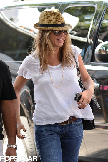 Jennifer Aniston reported to work in her straw fedora on July 31.