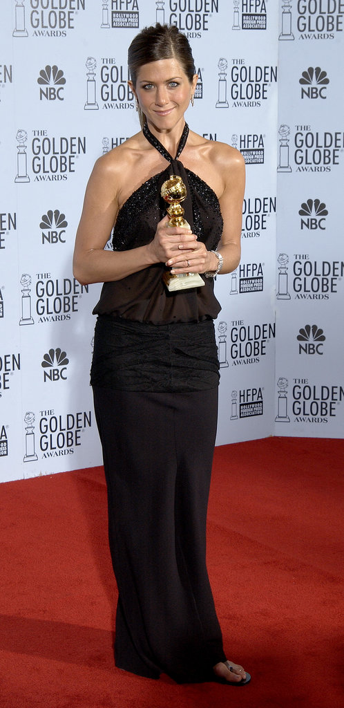 Jennifer proudly held onto her 2003 Golden Globe Award, rocking a black halter-style gown and slick side-parted ponytail.