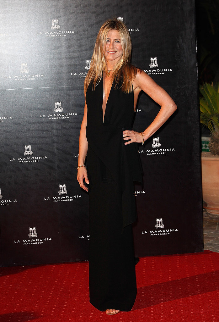 Jennifer Aniston celebrated the reopening of Morocco's Hotel La Mamounia working a sleek, black sash-tie halter, complete with plunging neckline and arm-baring open-back details, in 2009.