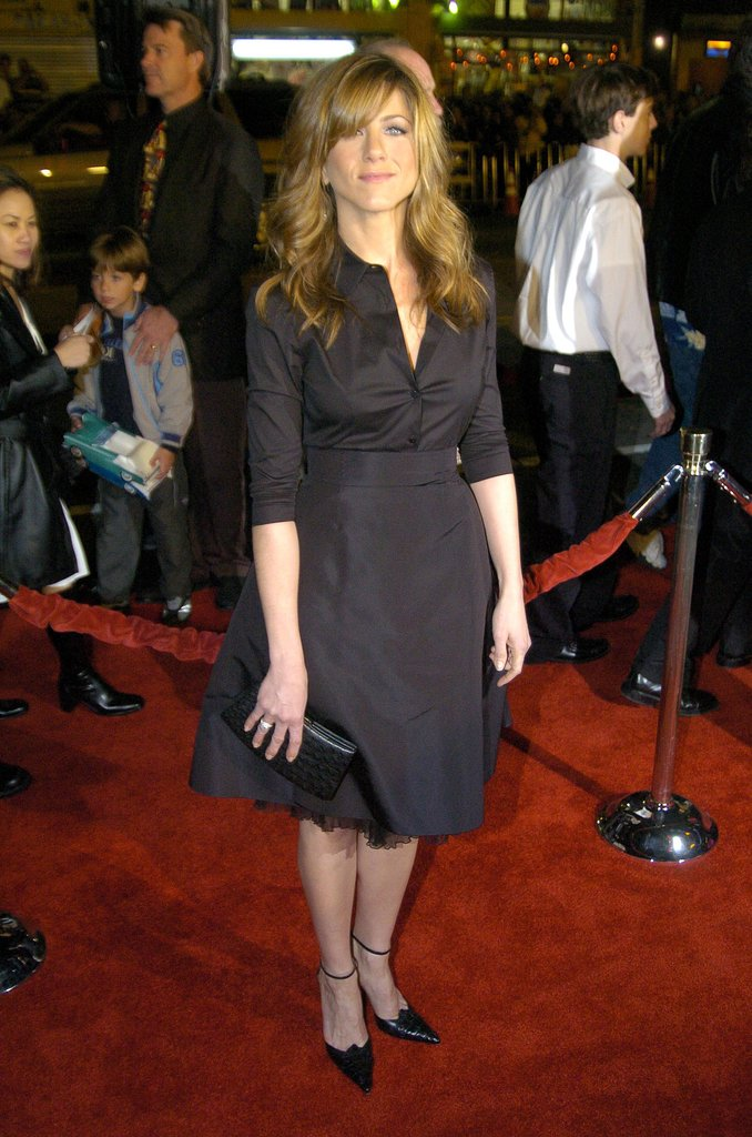 In 2004, Jennifer Aniston styled a more modest monochrome combo, crisp button-down blouse and full tulle skirt, for the Along Came Polly premiere in LA.