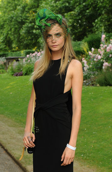 Cara Delevigne is a fan of fun hats and headpieces, but this lizard number she was sporting at a charity reception stole the show. Her subtle '60s-inspired eyeliner peeking out from under the netting was the perfect complement.