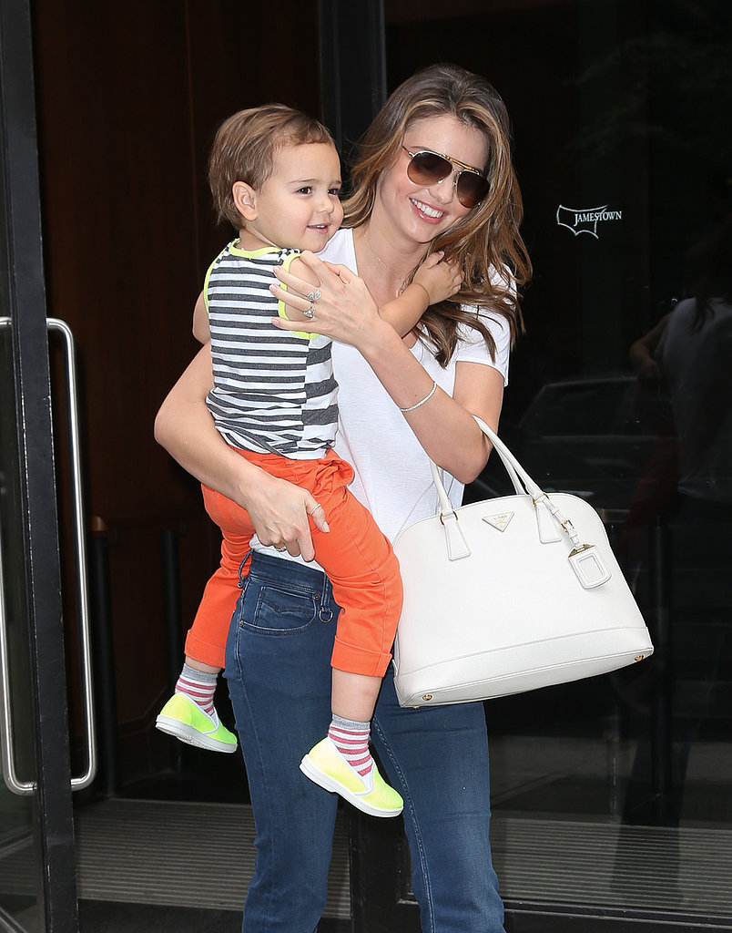 Miranda Kerr carried her little man, Flynn Bloom.