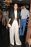 At the Lyst launch, Leandra Medine worked full trousers and a cropped top under her leather moto jacket.