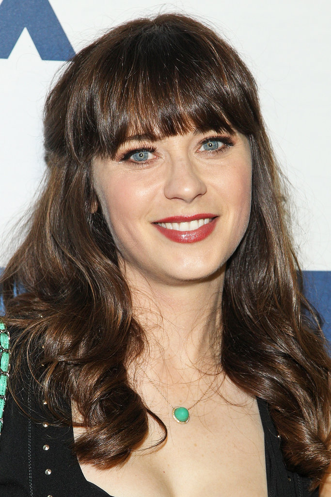 The New Girl star Zooey Deschanel was out at the Fox All-Star Party with her blunt bangs worn with a half-up style that had soft waves. She wore a copper eye shadow that was paired with a reddish lipstick.