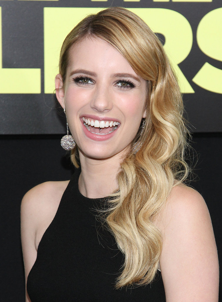 Emma Roberts was all smiles at the We're the Millers premiere. She wore her long, blond extensions in loose curls swept over her shoulder.