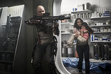 Matt Damon and Alice Braga in Elysium.