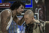 Wagner Moura and Matt Damon in Elysium.
