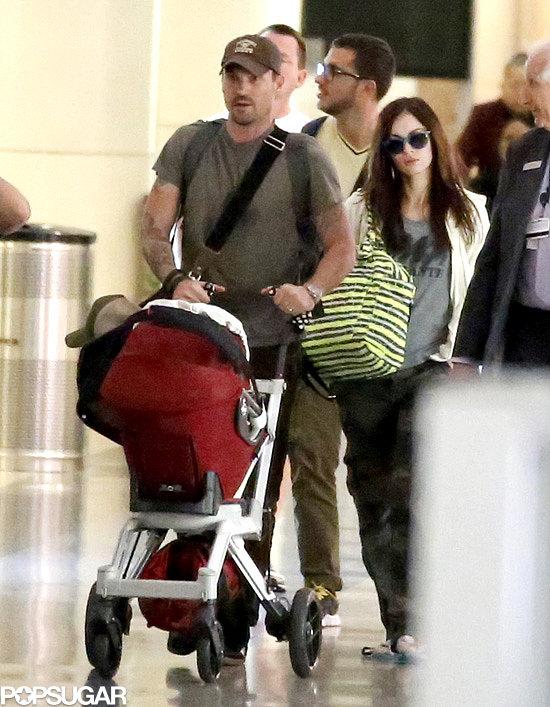 Pregnant Megan Fox and her husband, Brian Austin Green, made their way through JFK with their son, Noah.
