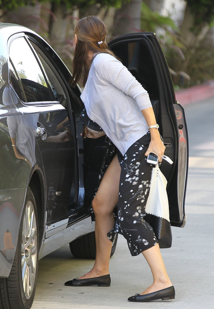 Jennifer Garner showed some skin as she reached to grab something out of her car.
