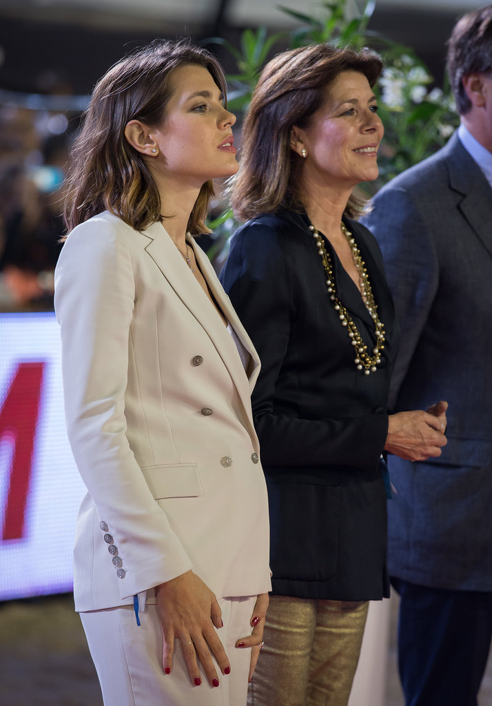 Charlotte stood with her mother, Princess Caroline, at an official event in late June 2013, when pregnancy rumors heated up.