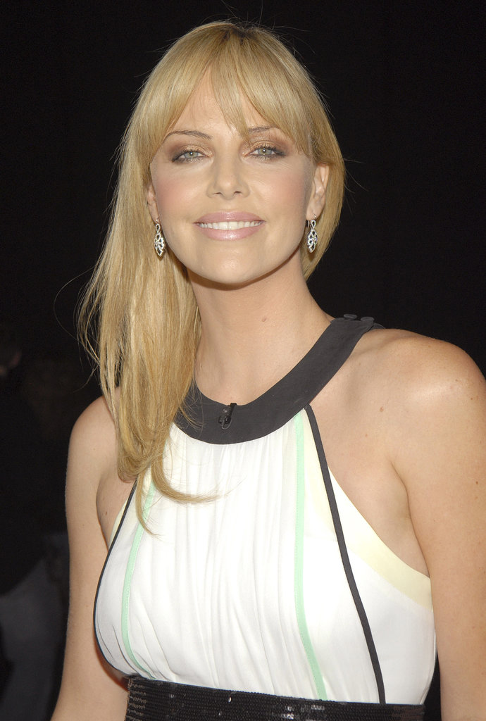 Ever the hair chameleon, Charlize changed up her bang look for a 2007 Condé Nast event, sweeping her fringe forward for a flirty finish.