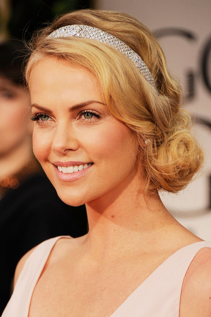 At the 2012 Golden Globe Awards, Charlize opted for a graceful, feminine look. She paired her ballet-pink lips with a sweet chignon, which was dressed up with a beautiful silver headband.