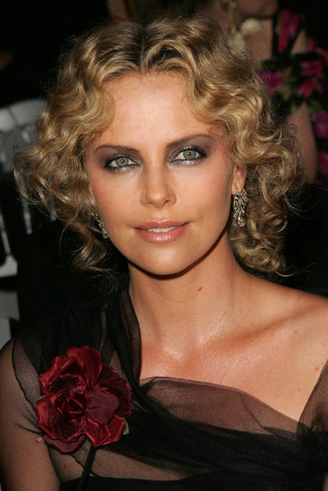 For Fall/Winter 2007 Paris Haute Couture Fashion Week, Charlize chose a full-on drama ensemble, coupling a metallic smoky eye with a curly, Parisian-chic undone updo.