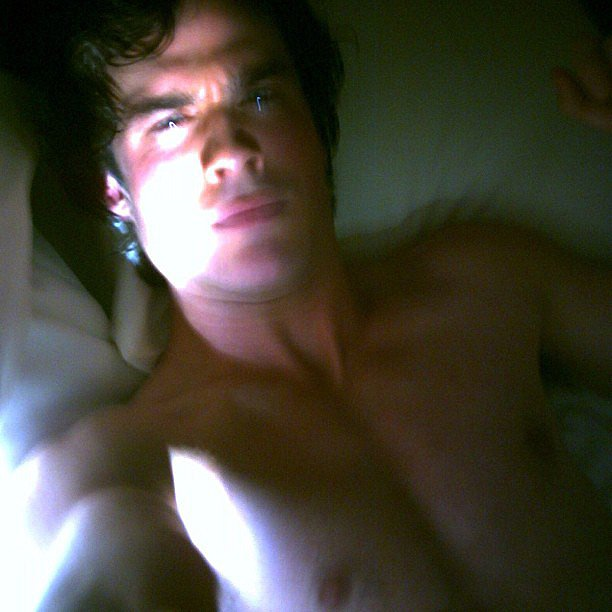 "Ian Somerhalder posted his shirtless selfie while on set with for The Vampire Diairies, along with the caption:  ""#throwbackthursdays Young Damon Salvatore on set selfie in bed with Katherine Pierce. Circa 1864"" Source: Instagram user iansomerhalder"