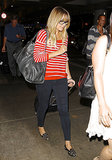 Lauren Conrad was comfortable but cute in a striped sweater, smoking slippers, and thick-rimmed glasses. Don't forget the oversize Balenciaga bag, either!