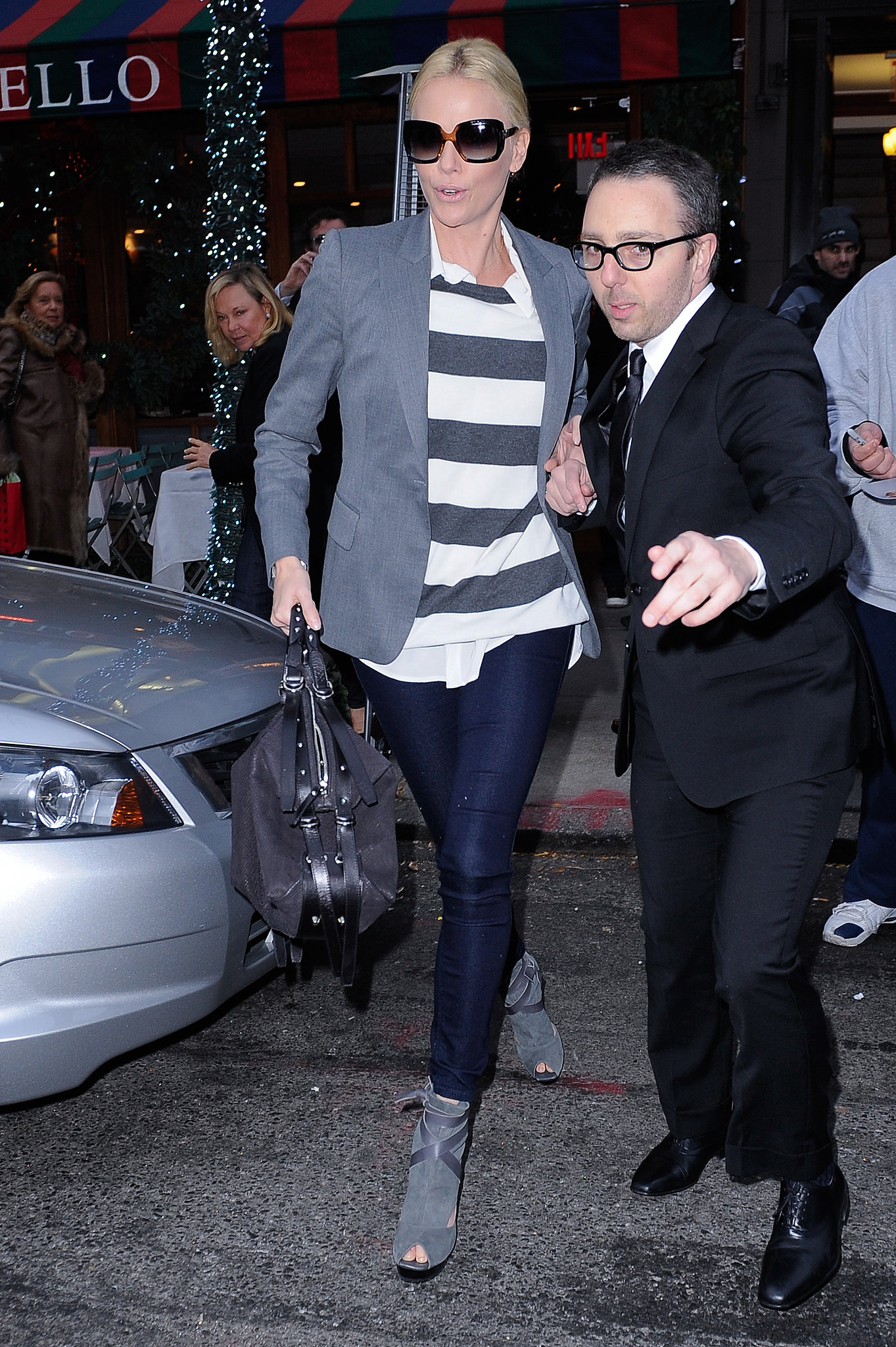 To lighten up a tailored silhouette, just add stripes — Charlize's off-duty attire here showca