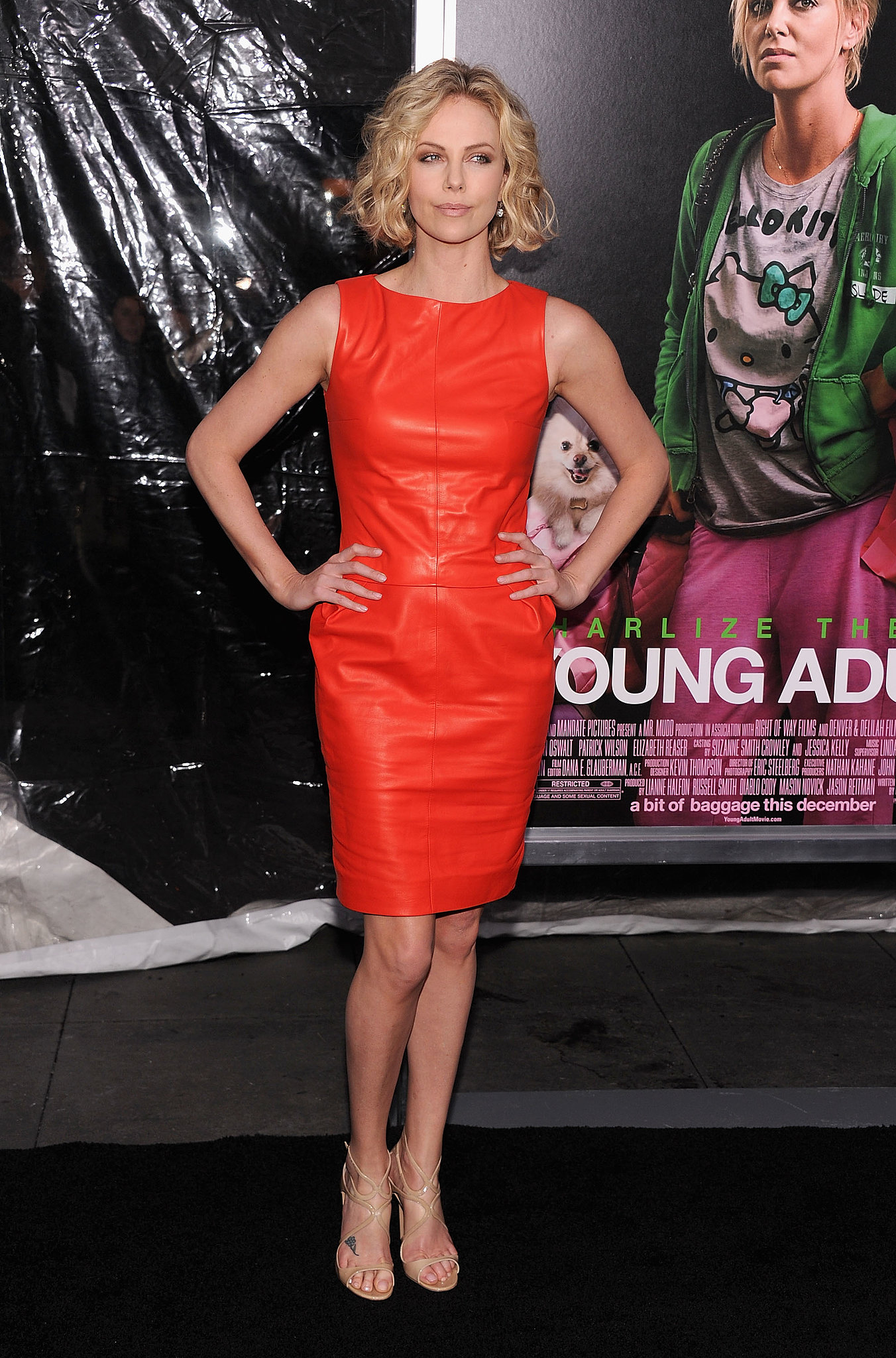 Va-va-voom! Charlize stunned in a siren red Dior sheath and gold Jimmy Choo sandals at the NYC premiere of Young Adult.