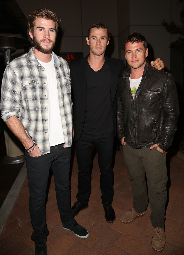 Chris linked up with his brothers Liam and Luke at an event in California in April 2013.