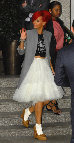 Rihanna took a romantic tulle skirt and turned it on its head — pairing it with a knotted tee, oversize blazer, and bow-detail pumps in London.
