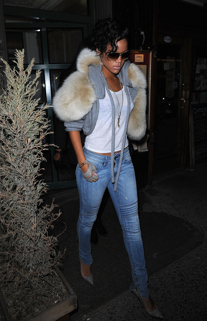 Rihanna amped up her closet staples with a fur-trim cardigan and fingerless leather gloves in March 2009.