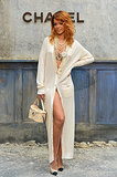 She nailed the boudoir vibe in a long cream cardigan — expertly cinched to show off her fit figure — dripping with statement-making necklaces, all by Chanel, during Paris Fashion Week Haute Couture Fashion Week 2013/2014.