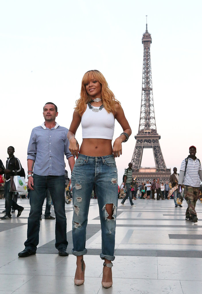 Why mess with a good thing? During a 2013 Parisian adventure, Rihanna topped her distressed boyfriend jeans with a white crop top and chain-link accessories — two necklaces, a bracelet, and anklet.
