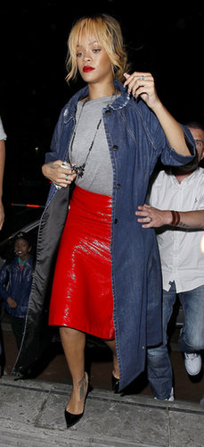 Rihanna blazed through Manchester in June 2013, donning a spicy patent-leather skirt and long denim jacket by Miu Miu.