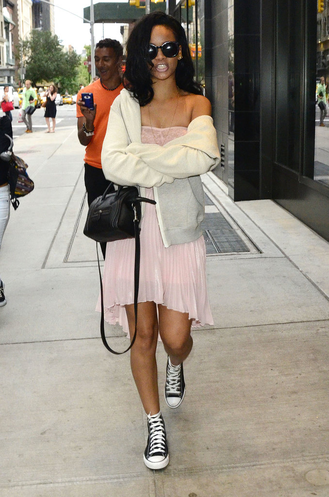 In 2012, the singer's NYC shopping look — soft-pink American Apparel lace bandeau top and pink pleated Topshop skirt — left little to the imagination. Rihanna completed her pretty pink style with black high-top Converse, oversize Karen Walker shades, and a mini Céline tote.
