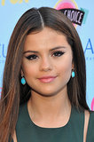Golden Girl Selena Gomez stuck to the basics at the Teen Choice Awards: a sexy cat eye and a flirty pink lipstick hue. Strategic contouring made this a standout look.
