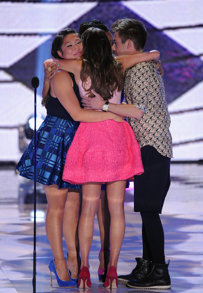 Lea Michele and her Glee costars hugged on stage at the Teen Choice Awards.