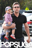Ben Affleck held Samuel, who wore a Boston Red Sox baseball hat, during the family's trip to the farmers market.