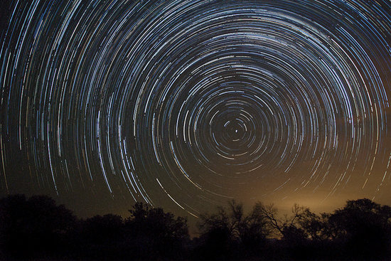 Star trails remind us of an easily forgotten fact: the Earth is constantly in rotation. We love the effects on display here, captured with an exposure of over two hours.  Source: Flickr user rarvesen