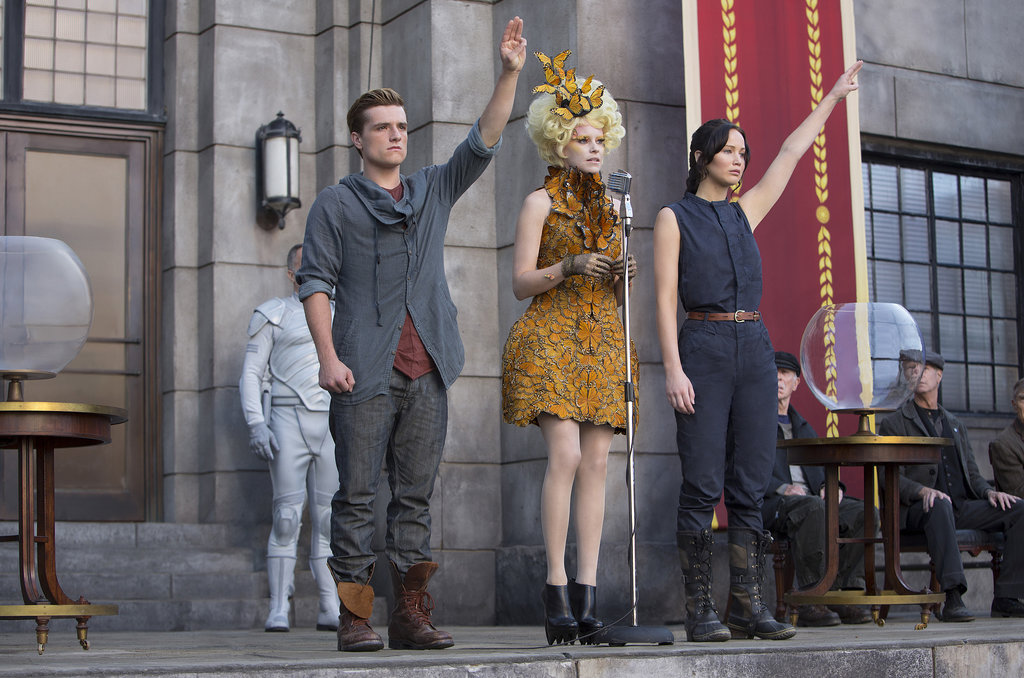Josh Hutcherson as Peeta, Elizabeth Banks as Effie and Jennifer Lawrence as Katniss in Catching Fire.