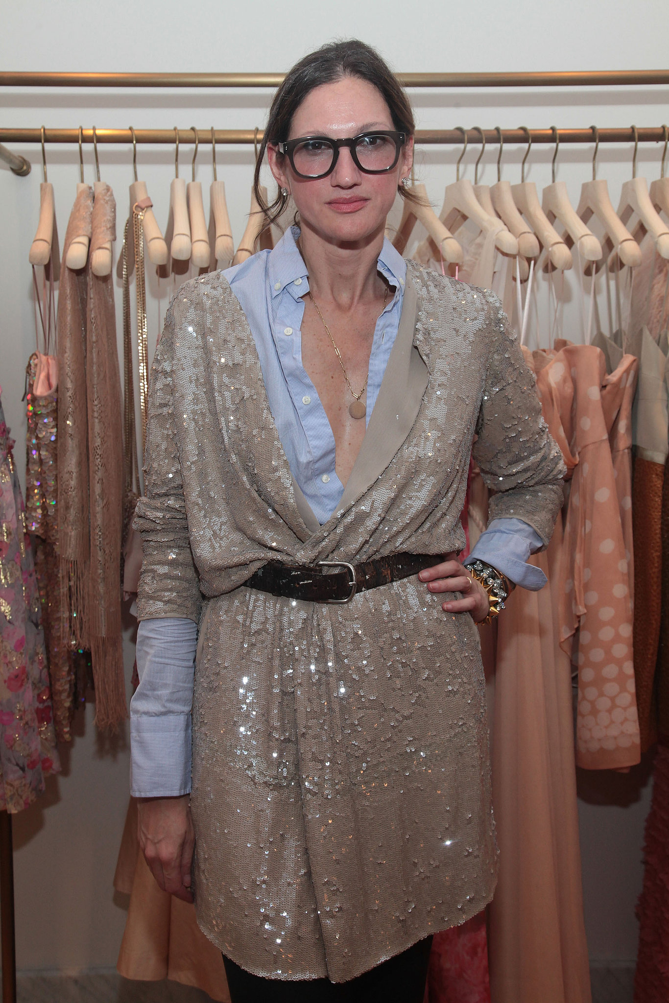 The idea of draping and belting a sequin cardigan over a preppy button-down feels novel but totally works.