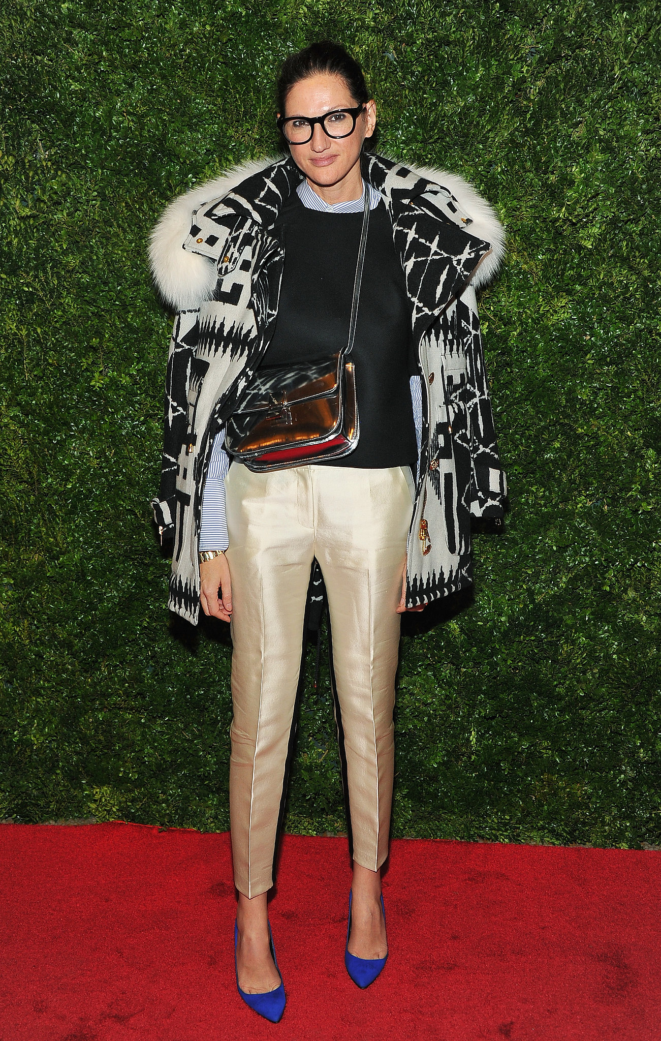 For a movie screening, Lyons paired all kinds of statement pieces together and made it work. Gold pants plus cobalt heels and a fur-trimmed parka? Yes!